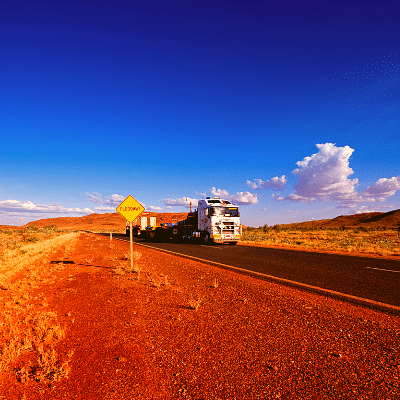 TRUCK ON ROAD TO WESTERN AUSTRALIA NORTH WESTERN AUSTRALIA FOR REMOVALS.  RED DIRT BLUE SKY